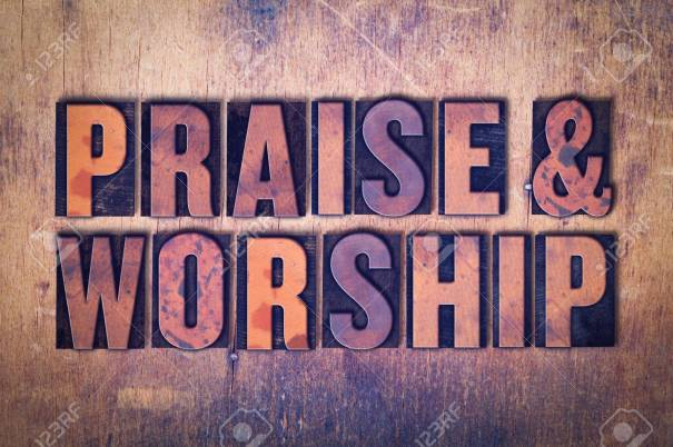 Praise  & Worship Theme Letterpress Word on Wood Background